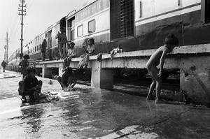 Street children washing their clothes, New Delhi Railway Station