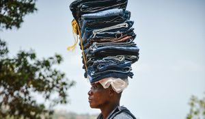 A street seller carries his wares on his head. Street sellers are common place in Sierra Leone.