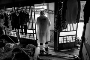 """Residents going back home to collect their belongings, Tomioka city, from the series Fukushima """"No Go"""" Zone, © Pierpaolo Mittica."""