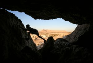 Shibam, Yemen: A young boy plays in a cave above the historic town. © Matjaz Krivic