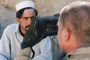 """An Afghan National Police officer suspected of trying to steal a US soldier's night vision goggles is enrolled in a biometric recognition system. The goggles, which are considered a """"sensitive item"""" and could have been sold to insurgents for  a high price, were recovered."""