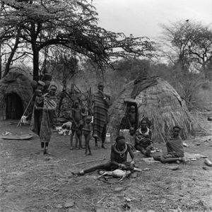 Group of women and children at a temporary settlement