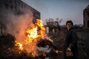 """Karine (57) - a neighbour from Gortsaranayin 2B, gathered all dry branches and bushes after the winter and launched a fire in between the two buildings. -""""I will burn everything here! Everything!"""" - she screams with a smile."""