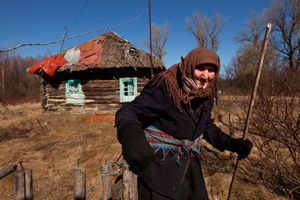 Teremtsy, Ukraine, 2011. Kharytina Desha, 92, is one of the few elderly people who have returned to their village homes inside the Exclusion Zone. Although surrounded by devastation and isolation, she prefers to die on her own soil.