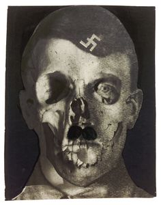 Erwin Blumenfeld, Grauenfresse / Hitler, Holland, 1933. Collage and ink on photomon- tage (gelatin silver print, double-exposition). Printed later. Collection Helaine and Yorick Blumenfeld, Courtesy of Modernism Inc., San Francisco © The Estate of Erwin Blumenfeld