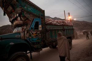 A salt miner and a truck laden with pink rock salt leave the Warcha salt mine at the end of the day