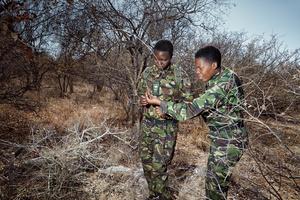 Black Mambas Yenzekile & Proud with snares at waterhole