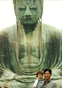 Father, daughter, and the Buddha.