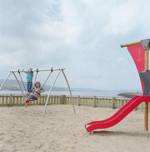 Sabina and Anhelina play at the park near the Fishguard