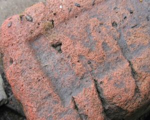 Orphan Brick - MAYONE brick fragment with MA heavily eroded (the remainder of the brick has long ago broken off).