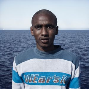 Mediterranean Sea, 1 August 2016. Ismaila (18), from Guinea, poses for a portrait minutes after being rescued on the Mediterranean Sea, 20 nautical miles off the Libyan coast by a rescue vessel provided by the NGO Jugend Rettet. The rubber boat in which he travelled carried 118 people on board, who were transferred by the Italian Coast Guard to Lampedusa (Italy).