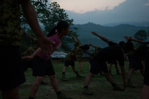 Training began every morning before sunrise at the KIA's military base outside of Laiza, Kachin State, Myanmar, May 21, 2013. Of the 215 soldiers completing the basic military training in Mai Ja Yang and Laiza, only 19 were women. © Adriane Ohanesian