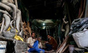 Workers taking a break at Kumartuli Potters' Colony, Kolkata