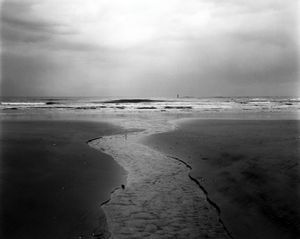 """Water goes into the Pacific Ocean near Iwaki city, some 40 km south of the Fukushima Daiichi nuclear plant. One of the biggest problems today is that contaminated water is still leaking into the ocean from the ruins of the nuclear plant. From the series """"Fragments/Fukushima"""" © Kosuke Okahara"""