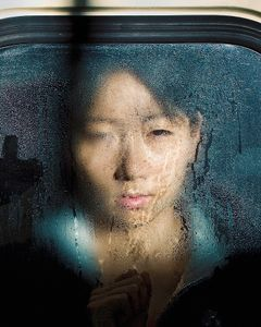 "From the series ""Tokyo Compression,"" a series of candid portraits of Japanese commuters enduring the inhuman daily crush of bodies in Tokyo's subway cars."