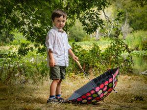 A Boy and His Umbrella