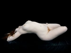 "Isley arched with white mice, 2010. From the series ""Bodies. 6 Women, 1 Man"" © Nadav Kander. Courtesy Flowers Gallery."