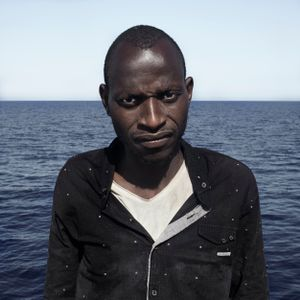 Mediterranean Sea, 1 August 2016. Mamadou (24), from Senegal, poses for a portrait minutes after being rescued on the Mediterranean Sea, 20 nautical miles off the Libyan coast by a rescue vessel provided by the NGO Jugend Rettet. The rubber boat in which he travelled carried 118 people on board, who were transferred by the Italian Coast Guard to Lampedusa (Italy).