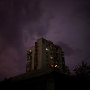 Apartment building lit up by lightning. Tiraspol, Transnistria.