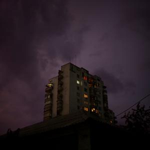 Apartment building lit up by lightning. Tiraspol, Transnistria.