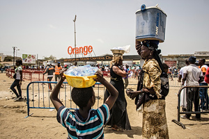 Wrestling fans and street vendors gather at the Demba Diop stadium in Dakar for the fight between the wrestling stars Balla Gaye 2 and Emeu Sene on April 5, 2015