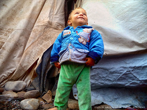 Pride and hope are the two emotions which young photographer Solin Qasem wished to express when she took this picture among the makeshift tents of the camp.