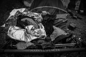 A Marks and Spencer trolley full of a homeless persons belongings.