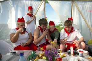 """Each year, the inhabitants of Norilsk celebrate the arrival of summer with joy. A three-day meeting is organized in the tundra, during which various competitions are held: canoeing, climbing and so on. Each team has its own motto, anthem and outfit. Here is a team called """"Pioneer of our Era"""", eating breakfast before a day of competition. © Elena Chernyshova"""