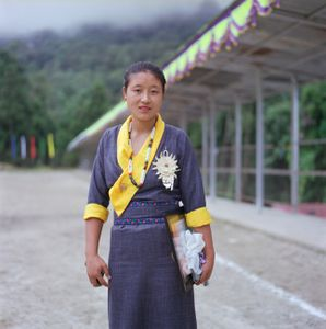 """Preparations for Independence Day, in traditional dress.  From the series """"Homebodies""""."""