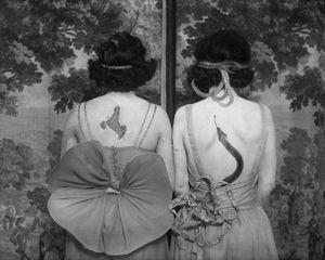 Women wearing tattoos and costumes © CORBIS