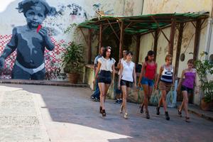 Teenage girls learning to walk in high heels, Havana