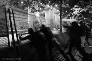 Activists push barricade.