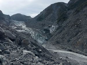 Klaus and his team had to overcome rocks, boulders, and trees to arrive at a ridge in which they could fully view and photograph the Fox Glacier.