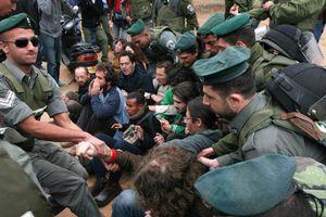 Israeli border policemen evict left-wing activists during the evacuation of 20 families from Kfar Shalem neighbourhood in Tel Aviv, Israel, 2008.