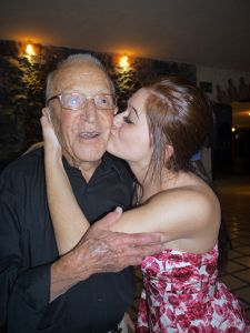 Girl Kissing her Grandfather