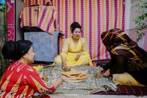 Uighur women chatting while enjoying afternoon tea in old Kashgar, Xinjiang Uighur Autonomous Region, China.