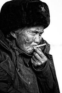 Smoking old chinese woman