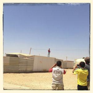 Omar*, Salem* and Michael take pictures of Hisham*