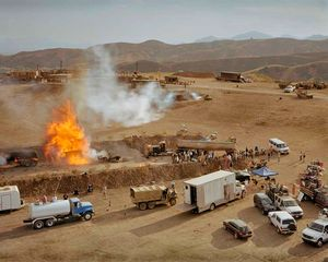 "A controlled explosion of an American fuel convoy in Iraq being filmed on the set of ?Over There?, a Fox TV production about the life of a US Army platoon in contemporary Iraq. Being filmed in Chatsworth, just north of Los Angeles. From ""Forensic Traces of War"" © Simon Norfolk"
