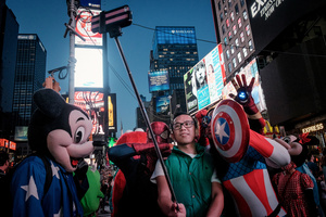 Times Square's bright lights attract around 50 billion visitors a year. Many of them want to take a souvenir of New York home with them.