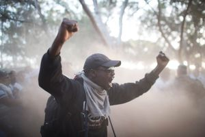 An African asylum seeker  shouts at Israeli policemen during the eviction of a protest camp of jailed asylum seekers on the Israeli-Egyptian border.