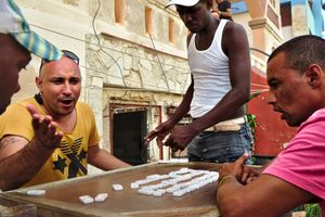 Playing domino in the street, rum was included in the mix.