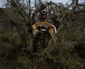 untitled hunter with springbok # I, eastern cape, south africa-from the series 'hunters'-David Chancellor