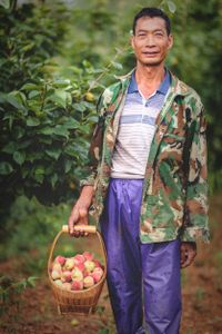 Xiong's leg was badly injured in an industrial accident at a factory. Support from the local Disabied Persons' Federation has allowed him to retrain as a farmer and provided the skills required to manage an orchard on his farm.