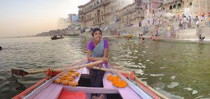 Barka Sells Diyas from Her Pink Rowboat