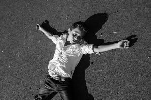 a Syrian boy pretends to be dead  © Alison McCauley