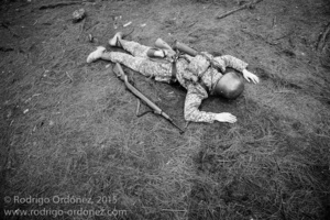 An Indonesian man dressed up as a German Waffen-SS soldier lies on the ground pretending to be dead during a gathering of re-enactment enthusiasts in Cibubur, East Jakarta, Indonesia.
