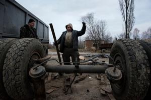workers dismantling radioactive scrap metals. Chernobyl Exclusion Zone