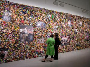 "From the series ""The Real Toy Story,"" Wolf's first major art project. The work was inspired by Wolf's childhood fascination with plastic toys (which were forbidden to him by his parents). By scouring the California coast, Wolf gathered over 20,000 toys which, when combined with portraits of Chinese workers, produced his first investigation into the broader contours of urban life."