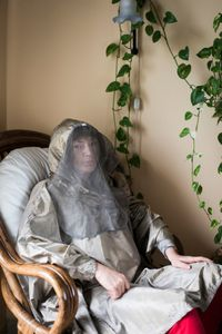 Erika, 53 years old, wearing her electromagnetic shielding clothes that she uses to go out.